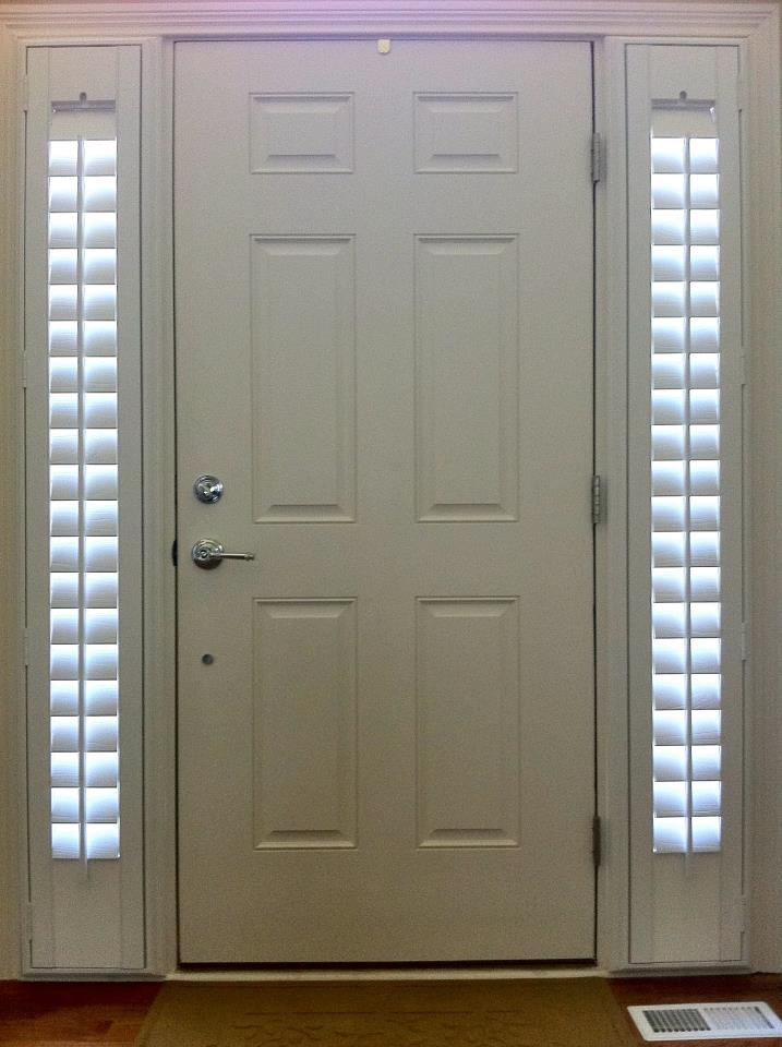 Shutters on the entry sidelights and front doors.