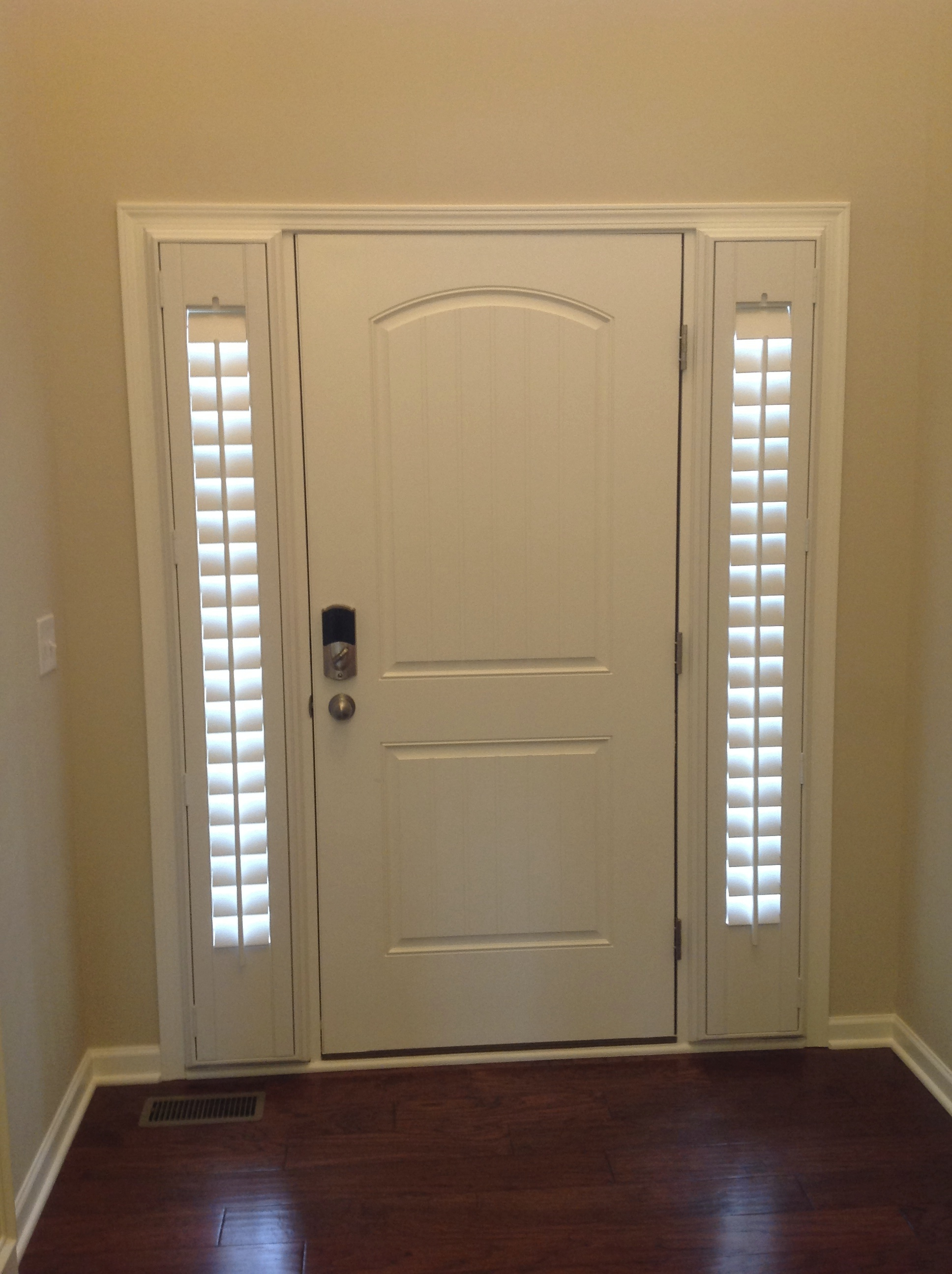 shutters on the entry sidelights and front doors